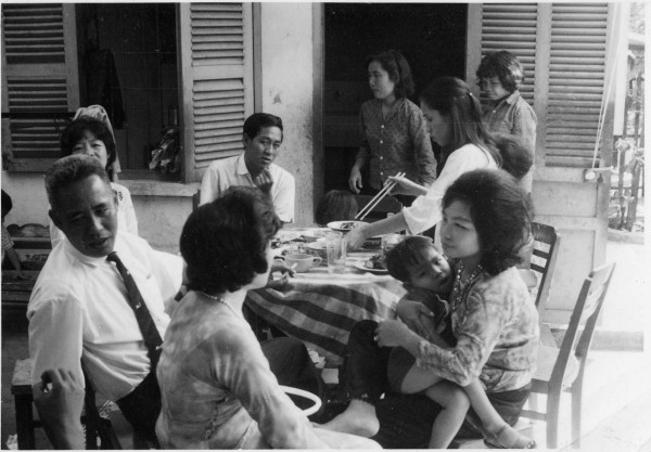 Lunch at Andrew Lam's uncle's villa in Saigon in 1972. Lam is in his mother's arms. Photo courtesy of the author.